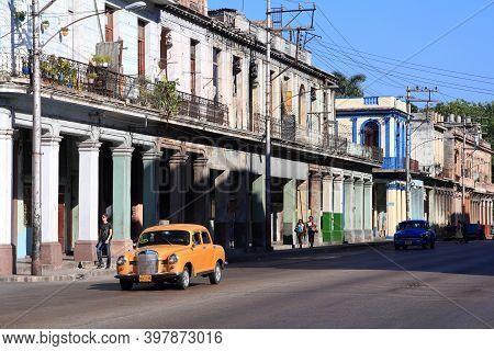 Havana, Cuba - February 24, 2011: People Drive Old Car In Havana. Cuba Has One Of The Lowest Car-per