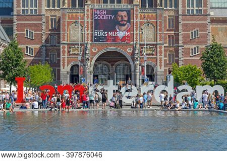 Amsterdam, Netherlands - May 15, 2018: Big Letters And Tourists At Rijksmuseum Museum Square In Amst