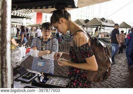 São Paulo / São Paulo / Brazil - 08 19 2018: Pretty Model Woman Choosing A Ring To Buy At A Market P