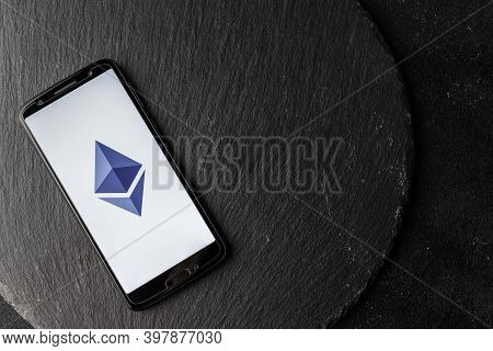 Logo Of Ethereum Blockchain Money Cryptocurrency On Screen Of Smartphone.