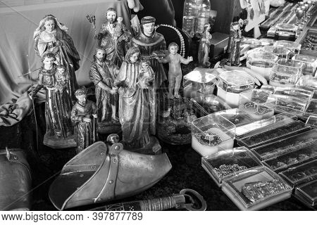 Religious Icons And Objects Grouped - Scultures And Statues. Also, Gold And Silver Jewelery. [black