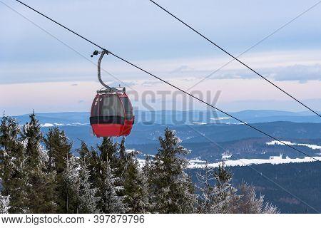 Red Gondolas Of Ski Flit At Jaworzyna Krynicka Mountain In Beskid Sadecki Mountain Range, Poland