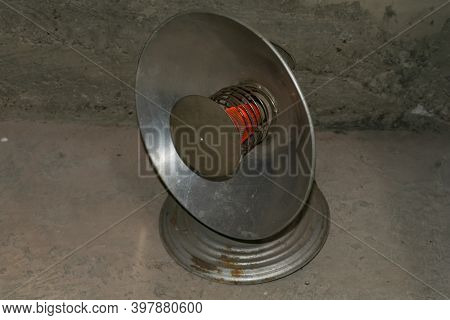Full-face Of An Old Reflex Heater With The Heated Spiral It Is Isolated On The Black.