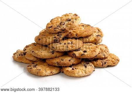 Pile of appetizing chocolate chip cookies. Isolated on white background