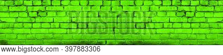 Bright Vivid Green Brick Wall Background. Aged Wall Texture Toned. Distressed Brickwork. Grungy Blac