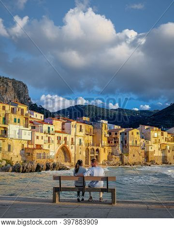 Cefalu, The Medieval Village Of Sicily Island, Province Of Palermo, Italy. Europe, A Couple On Vacat