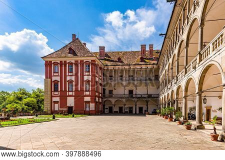 Opocno, Czech Republic - June 16 2020: View Of The Castle Courtyard With Arcades And Red Facade. Gre