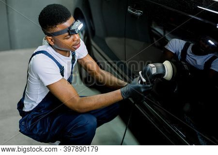 Auto Detailing Service, Polishing Of The Car. Side View Of Young African American Man Worker In T-sh