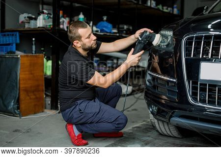 Car Detailing Series, Polishing Concept. Professional Male Auto Service Worker, Waxing And Polishing