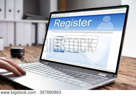 Filling Online Website Registration Form On Laptop