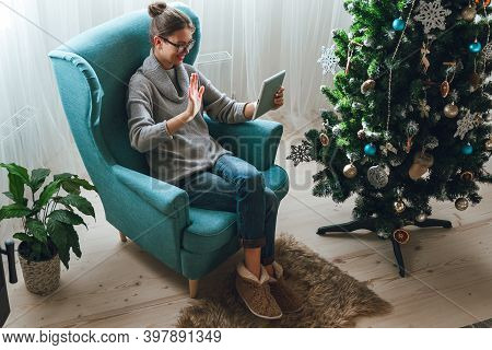 Young Woman With Tablet On The Background Of A Christmas Tree Ac