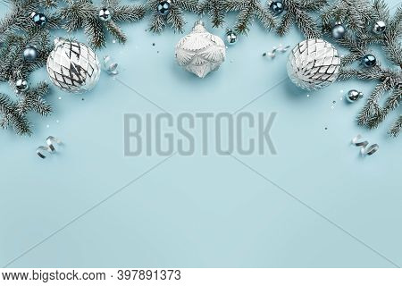 Christmas Fir Branches, White Decoration, Pine Cones, Confetti On Blue Holiday Background. Merry Chr