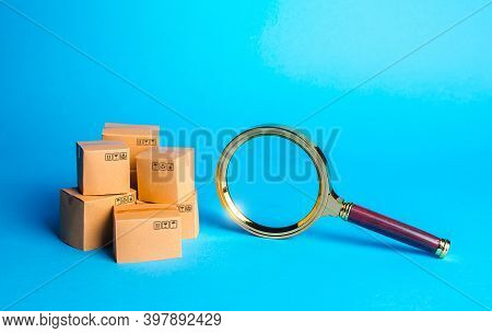 Pile Of Boxes And Magnifying Glass. Procurement Audit. Monitoring And Verification Of Goods, Import