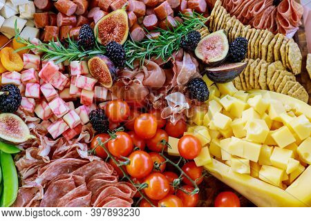 Charcuterie Board With Variety Or Assortment Of Cheese, Fruits And Deli. Full Frame.