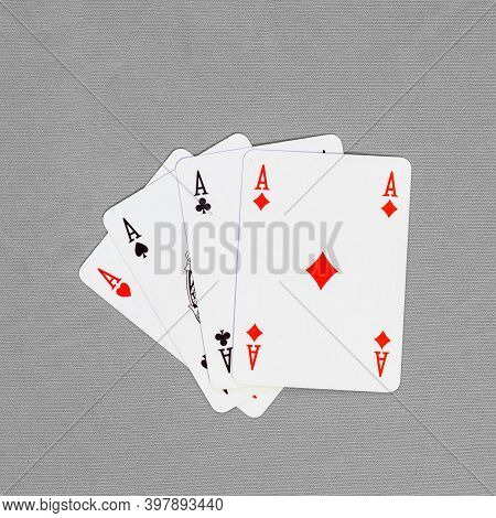 Four Playing Cards Depicting Aces, Clubs, Spades, Diamonds, Hearts On A Colored Background