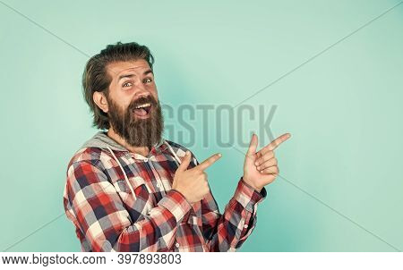 Look At This. Portrait Of Handsome Bearded Man In Plaid Shirt. Man Wearing Casual Clothes. Brutal Ha