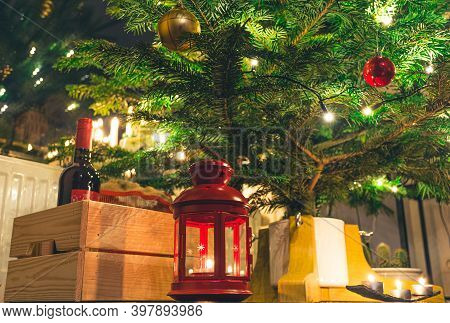 Beautiful Christmas Tree With Scandinavian Candelier, Ornaments And Lights, Candles, Lantern And Bot