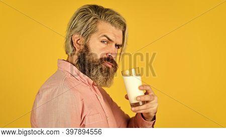 Milk For Good Health. Lactose Free. Bearded Man Hold Glass Of Milk. Vegan Milk Concept. Drink Protei