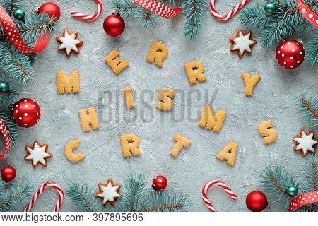 Dyslexia Awareness, Disorganized Cookie Letters Spelling Merry Christmas. Fir Twigs And Xmas Decor.