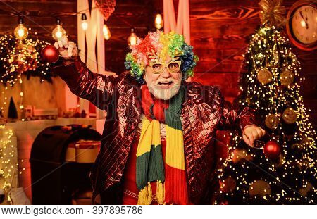 Cheerful Clown Colorful Hairstyle. Bearded Grandfather Senior Man Celebrate Christmas. Mature Man Wi