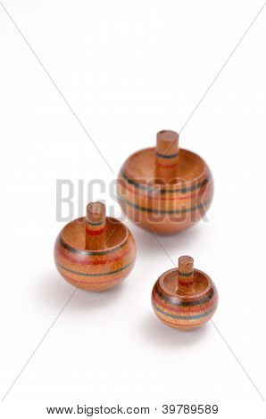 The Koma (spinning top). on white background. poster