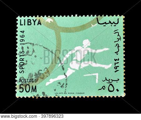 Libya - Circa 1964 : Cancelled Postage Stamp Printed By Libya, That Shows Race With Hurdles, Circa 1