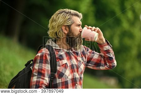 Drinking Hot Coffee. Enjoying Nature At Riverside. Guy With Backpack Relaxing. Inspiration. Inspired