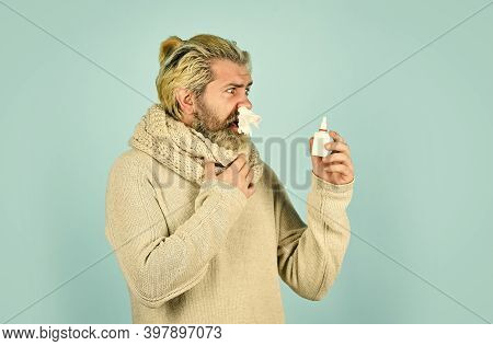 Cold Flu Remedies. Man Scarf Hold Nasal Spray. Medicines Effective Recovery. Allergy Medical Treatme