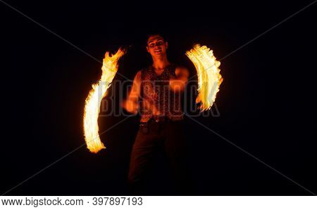 Fakir Show. Happy Man Manipulate With Burning Poi. Fire Fakir Perform Dangerous Tricks. Flame Tails