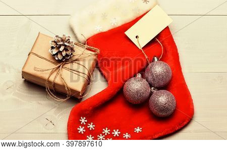 Christmas Decorative Sock Light Background Top View. Christmas Stocking Sock Shaped Bag Fill With Pr