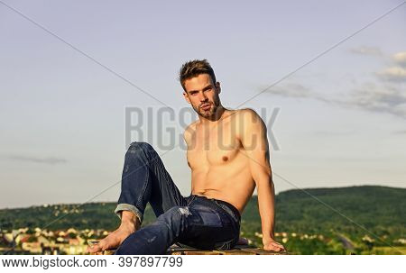 Muscular Bare Torso. Six Packs Muscular Chest. Man Outdoors Blue Sky Background. Male Beauty Concept