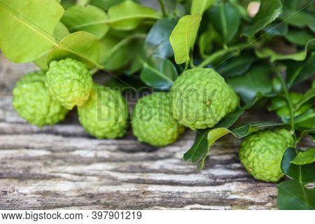 Fresh Bergamot Fruit , Kaffir Lime, Citrus Bergamia With Leaf On Wooden Table, Slice Bergamot Citrus