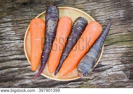 Carrot And Purple Carrot On Tray, Fresh Carrot For Cooking Vegetarian On Wooden Table In The Kitchen