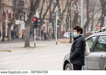 Belgrade, Serbia - November 18, 2020: Old Woman Walking And Looking At A Street Traffic On A Bouleva