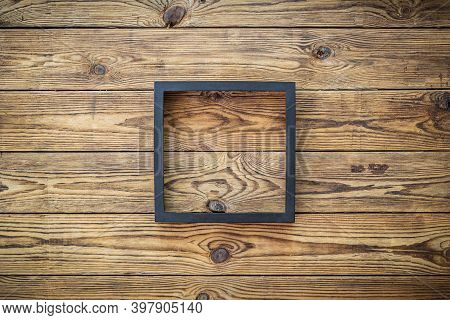 Wooden Frame Or Photo Frame Over Wooden Background, Copy Space, Design And Home Interior.