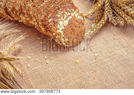 Rye Bread. Bakery With Crusty Loaves And Crumbs. Fresh Loaf Of Rustic Traditional Bread With Wheat G