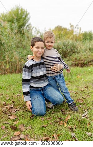 Little Brothers Embracing And Laughing. Love, Trust And Tenderness. Two Boys Having Fun Together Out