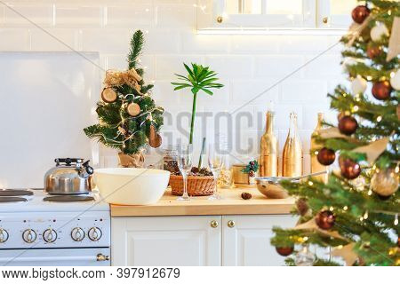 Gala Dinner. Cooking At Christmas. New Years Interior In The Kitchen. Decorations Christmas Tree, Ga