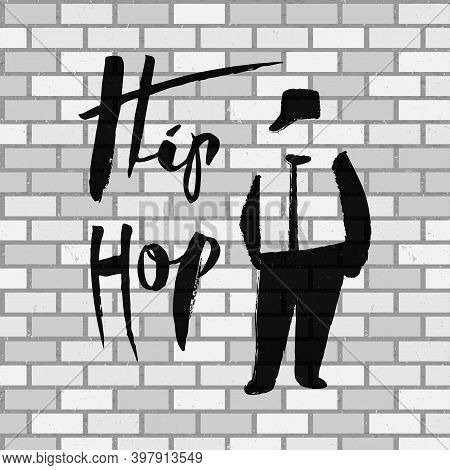 Black Silhouette Of A Rapper And Lettering On A Brick Wall Background. A Male Street Dance Hip Hop D
