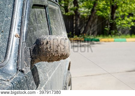 The Side Mirror Of The Car Is Splashed With Mud And Earth. Off-road Vehicle After Driving On Clay So