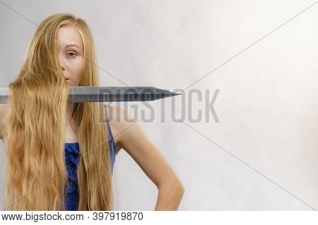 Haircut Coiffure Haircare Concept. Crazy Girl With Long Blonde Hair Holding Sword, Showing Tools For