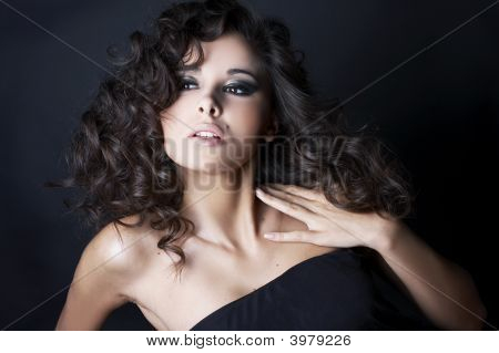Beautiful Brunette Posing On Black Background In Studio