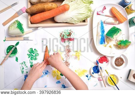 Top View Close Up Of Toddler Boy Child Hands, Kid Making Artwork From Vegetable Stamping At Home, Fu