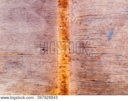 Faded Texture Of A Wooden Plank Surface With Rusty Spots. Rusty Metal Stains On A Wooden Board. Boug