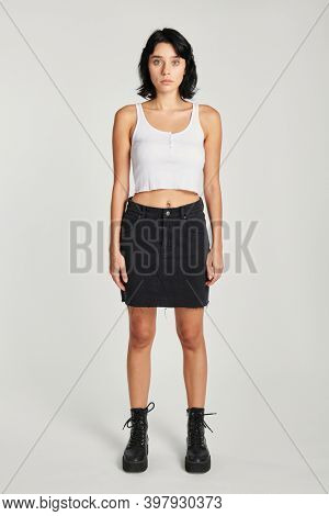 Cool woman in a black skirt and a white cropped top mockup