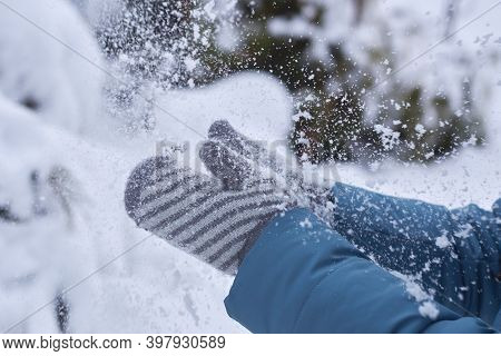 Woman In Mittens Claps Hands In The Snow, Wintertime.