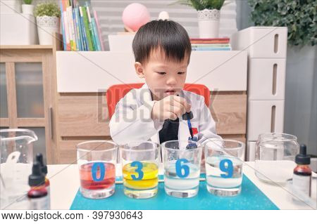 Little Asian Kindergarten Kid Studying Science, Making Sugar Water Density Experiment With Sugar, Wa