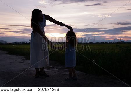 Young Mother And Daugther Play At Night Near Rice Field, Nature, Travel