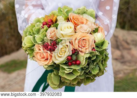 The Bride Holds A Beautiful Bouquet Of Roses On Her Wedding Day. Floristics And Decor, Wedding Organ