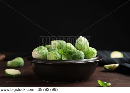 Bowl With Fresh Brussels Sprouts On Brown Wooden Table, Closeup